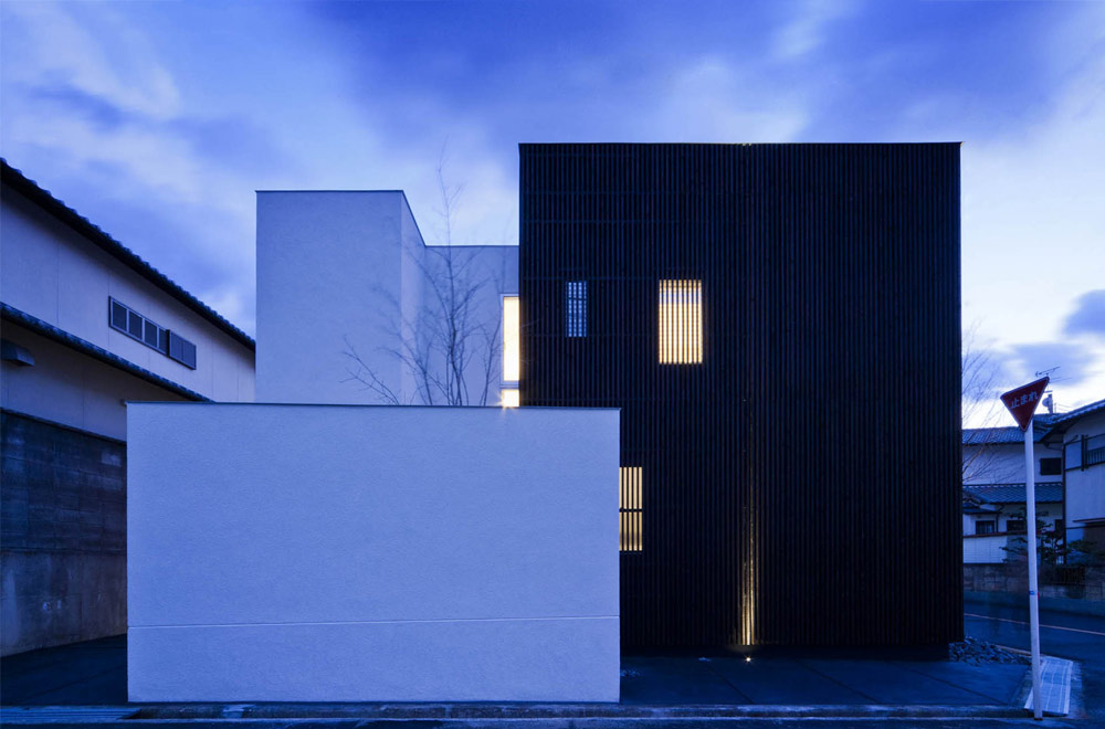 HOUSE WITH A LOUVER TOWER: Facade (Evening)